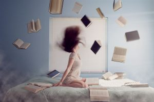 Woman throwing books